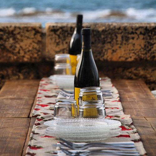 Close-up of wine bottles and glasses on dining table
