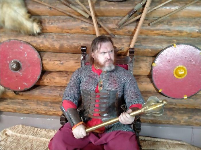 Full length of man standing on wood