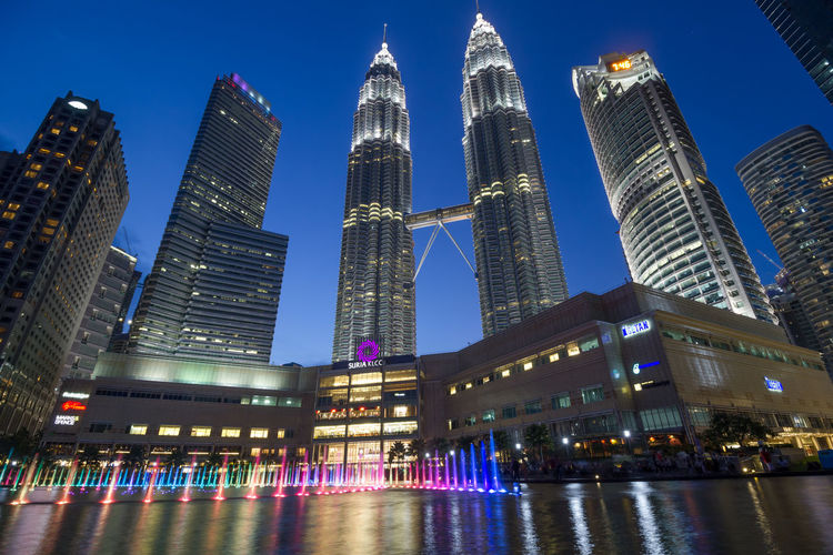 Architecture Building Exterior Built Structure City Illuminated Klcc Low Angle View Modern No People Outdoors Sky Skyscraper Travel Destinations Urban Skyline Water