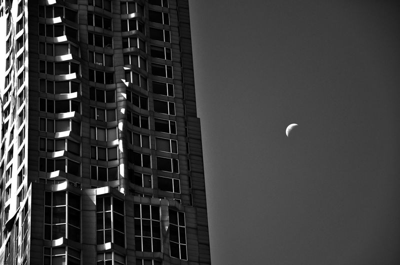 Low Angle View Of Buildings Against Clear Sky At Night