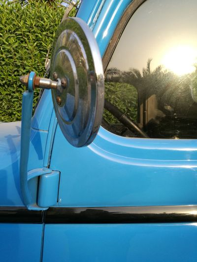 Metal No People Outdoors Close-up Transportation Sideview Vehicle Day Commercial Land Vehicle Semi-truck Vintage Cars blue colors Mode Of Transport Land Vehicle Blue Colored Photos Side-view Mirror Reflection