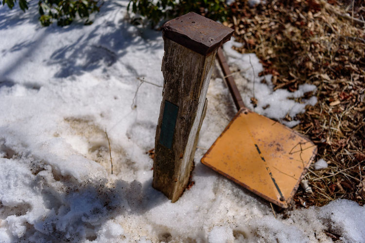 Winter Nature Snow No People High Angle View Cold Temperature Day Land Outdoors Field Plant Communication Wood - Material Grave Tree Close-up Metal Hand Tool Cemetery