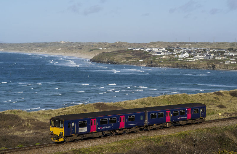 train runs along side the coast on the line between St Ives and Hayle in Cornwall Coastline Cornwall Sea Track Train Transportation Travel Waves