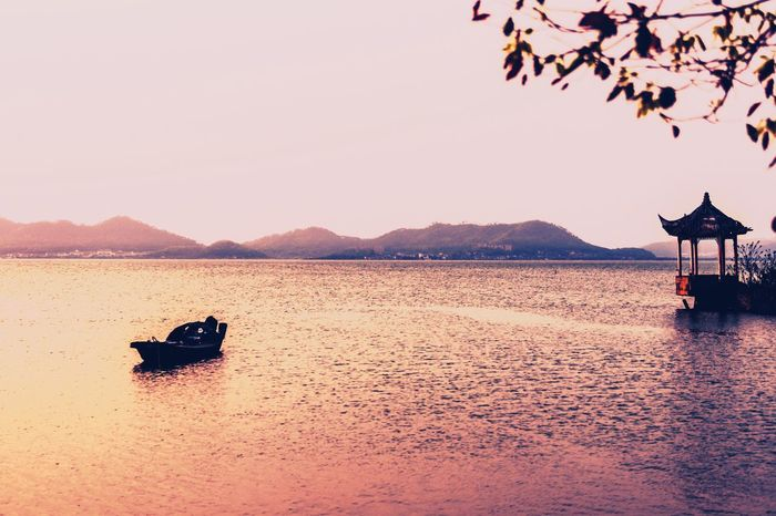 My Street Photography From My Point Of View My Traveling Photography Water Lake Boat Sunset Nature Beauty In Nature Nautical Vessel Waterfront Clear Sky No People Mountain Scenics Taking Photos Capture The Moment Peaceful Place Peace And Quiet Exceptional Photographs