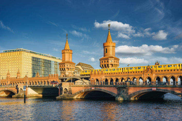 Famous Oberbaum bridge traversing Spree river Friedrichshain Historical Building Kreuzberg Spree Sunny Tourist Attraction  Arch Architecture Brick Building Bridge - Man Made Structure Building Exterior Built Structure City Cloud - Sky Connection Day Landmark Outdoors River Sky Towers Transportation Travel Destinations Water Waterfront