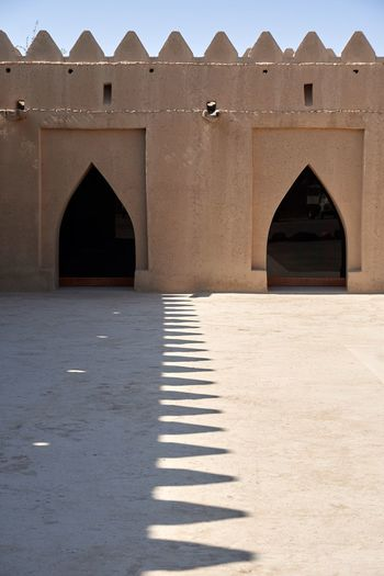 Serrated Shadow Arabian Abudhabi Alain Middle East Historical Monuments Arch Architecture Built Structure Day Sunlight History The Graphic City Travel Destinations Building Exterior No People Shadow Outdoors