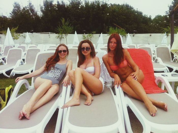 Friendship Summer Young Adult Leisure Activity Vacations Sitting Only Women Youth Culture Swimming Pool People Bikini Relaxation Outdoors Fun Sunglasses Adults Only Togetherness Young Women Pool Party Day