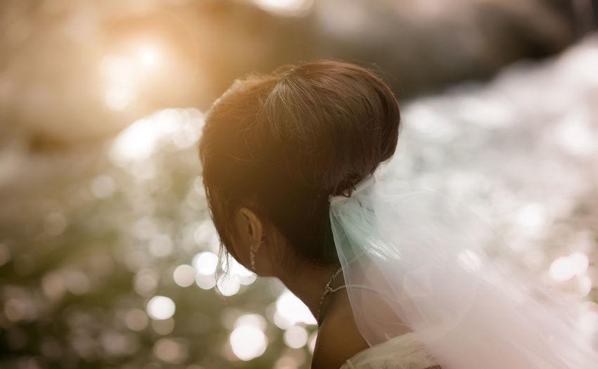 Bride in wedding dress looking away