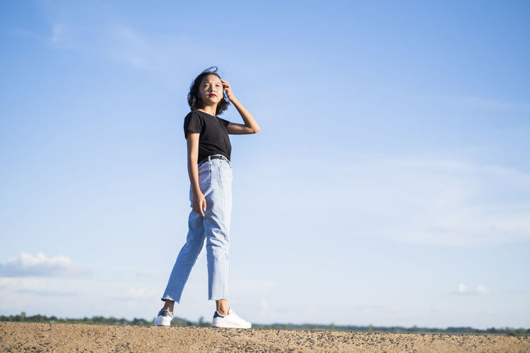 Happy young asian girl with blue sky.
