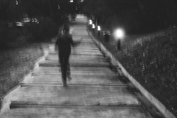 Children Escaping Memories Panic Running Stairs Childhood Full Length Illuminated Motion Nature Night Nightmare One Person Outdoors People Real People Rear View The Way Forward Walking Lighting Equipment Walkway