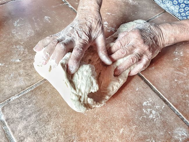 Real People Human Hand Human Body Part High Angle View Indoors  One Person Preparation  Dough People Day EyeEm Ready   EyeEmNewHere Food Stories Business Stories Preparation  Indoors  Low Section Kneading