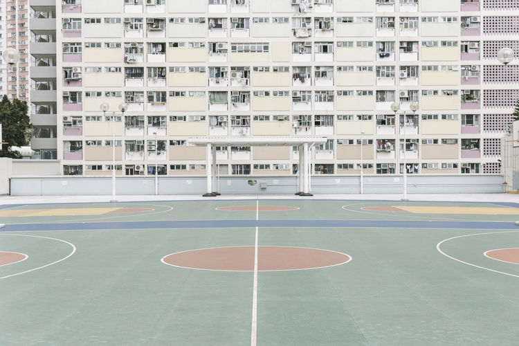 High angle view of empty court by buildings