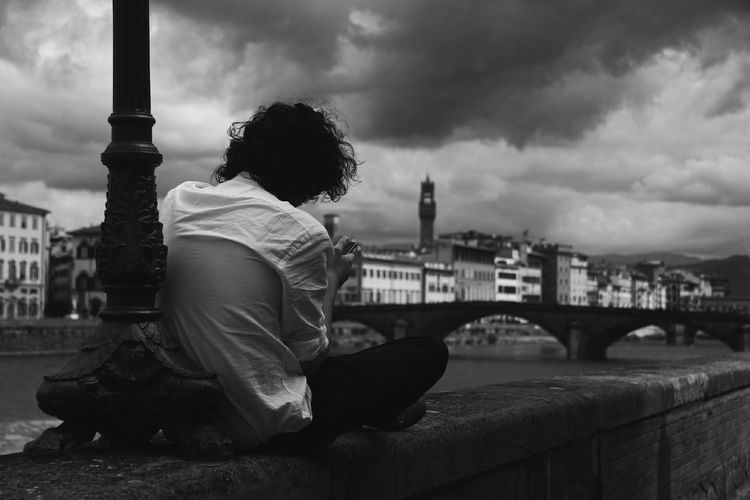 Me time in mobile Architecture Bridge - Man Made Structure Built Structure River Arno River One Person Urban Skyline Cityscape Cloud - Sky Bw Bw_collection BW_photography Bw_lover Black And White Photography Black And White Young Adult Outdoors Sky Black And White Friday Stories From The City