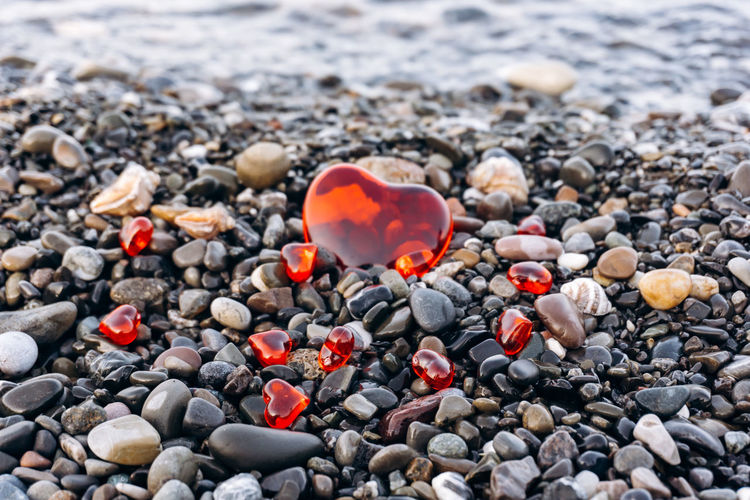 High angle view of stones with heart shapes at beach