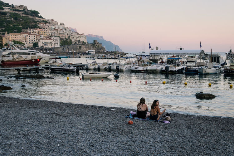 Amalfi, Campania - 2018 FUJIFILM X-T2 Adult Architecture Building Exterior Built Structure Fujifilm Fujifilm_xseries Fujixseries Group Of People Leisure Activity Lifestyles Men Mode Of Transportation Nature Nautical Vessel Outdoors Real People Sea Serene Sitting Sky Sunset Transportation Water Women My Best Photo International Women's Day 2019 Streetwise Photography