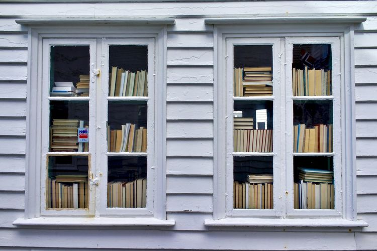 Norway, Haugesund: books seen from windows Day Daylight Daytime House Architecture Book Bookshelf Window Reading Several Object Separation Nobody No One No People Wood - Material Building Exterior Full Frame Building Built Structure Outdoors Residential District Shelf Pattern In A Row Backgrounds White Color Glass - Material City Side By Side