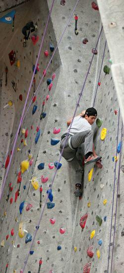 Full length of boy climbing on wall