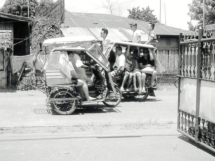 Tricycle - a mode of transpo that has the capacity of up to 15 people depending on the body built of its sidecar. Philippines Albay,bicol Public Transportation Blackandwhite Open Edit Eyeem Philippines
