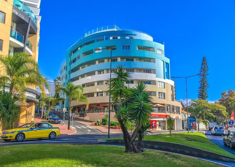 Architecture Built Structure Building Exterior Blue Car Clear Sky Tree Day Mode Of Transport Palm Tree Land Vehicle Outdoors Sunlight Growth Transportation Modern No People City Nature Sky Portugal Madeira Cityscape Architecture Scenics Residential Building