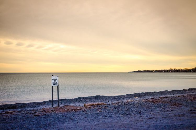 Beauty In Nature Calm Cloud Cloud - Sky Cloudy Coastline Horizon Over Water Idyllic Lake Ontario Nature No People Non-urban Scene Orange Color Outdoors Picton  Prince Edward County Remote Shore Sign Sky Sunset Tranquil Scene Tranquility Water Weather