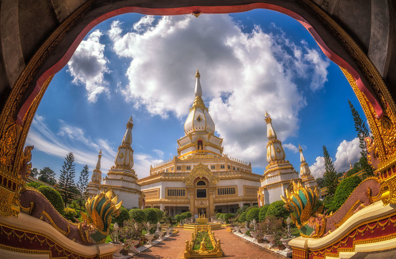 The beauty of Chai Mongkol Chedi in Wat Pha Nam Thip Prasit Wanaram, Roi Et Province. Architecture Building Exterior Built Structure Cloud - Sky Day Fish-eye Lens Golden Color Nature No People Outdoors Place Of Worship Religion Sculpture Sky Spirituality Statue Thailand; Religion; Architecture; Chedi; Buddha; Roi; Phra; Maha; Chai; Travel; Pagoda; Design; Temple; White; Roi-ed; Asia; Thai; Buddhism; Wat; Building; Traditional; People; Tourism; Culture; Ancient; Landmark; Tourist; Place; Buddhist; Landscape; Marc Travel Destinations Tree