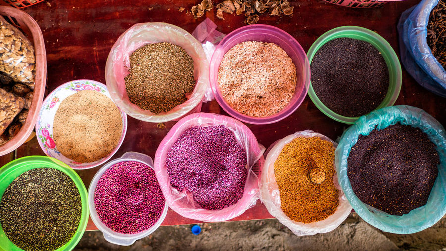 High angle view of multi colored food at market stall for sale