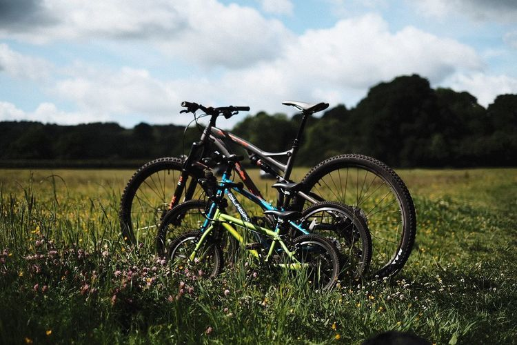 Nature Bikes Bikesaroundtheworld Bicycle Field Grass Sky Transportation Cloud - Sky Day Nature Outdoors No People Green Color Landscape Stationary Adventure Growth