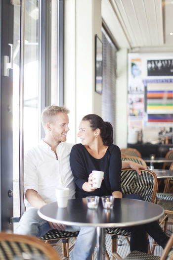 Man and woman sitting in restaurant