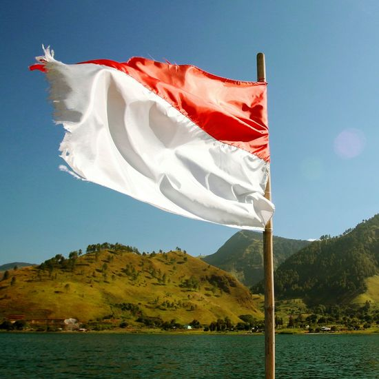 Flag Indonesian Stockphoto EyeEm Selects Flag Patriotism Wind Day Outdoors No People Sky