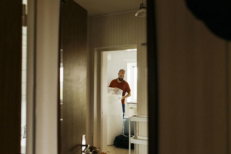 Man standing by door at home