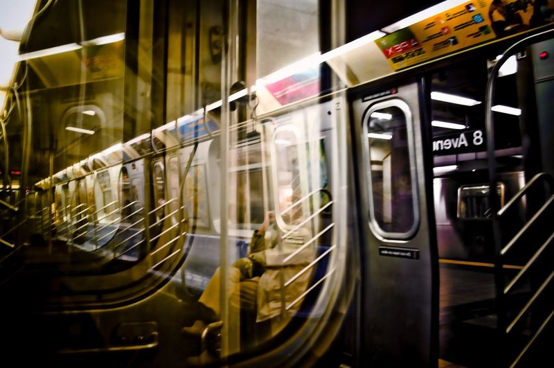 Man on the train. Subway Subway People Through The Window Subway Station L Train 8th Avenue  Subway Train People Watching Reflection Through The Looking Glass Looking To The Other Side On And On FiveSigmaPhoto City Life Backwards  The Graphic City