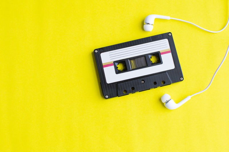 Tape Cassette Retro Old Vintage Technology Yellow Music Electricity  Indoors  Cable Studio Shot Connection Copy Space Listening No People Electric Plug Equipment Yellow Background Colored Background High Angle View Headphones Communication Still Life Power Supply Electrical Equipment Electrical Component