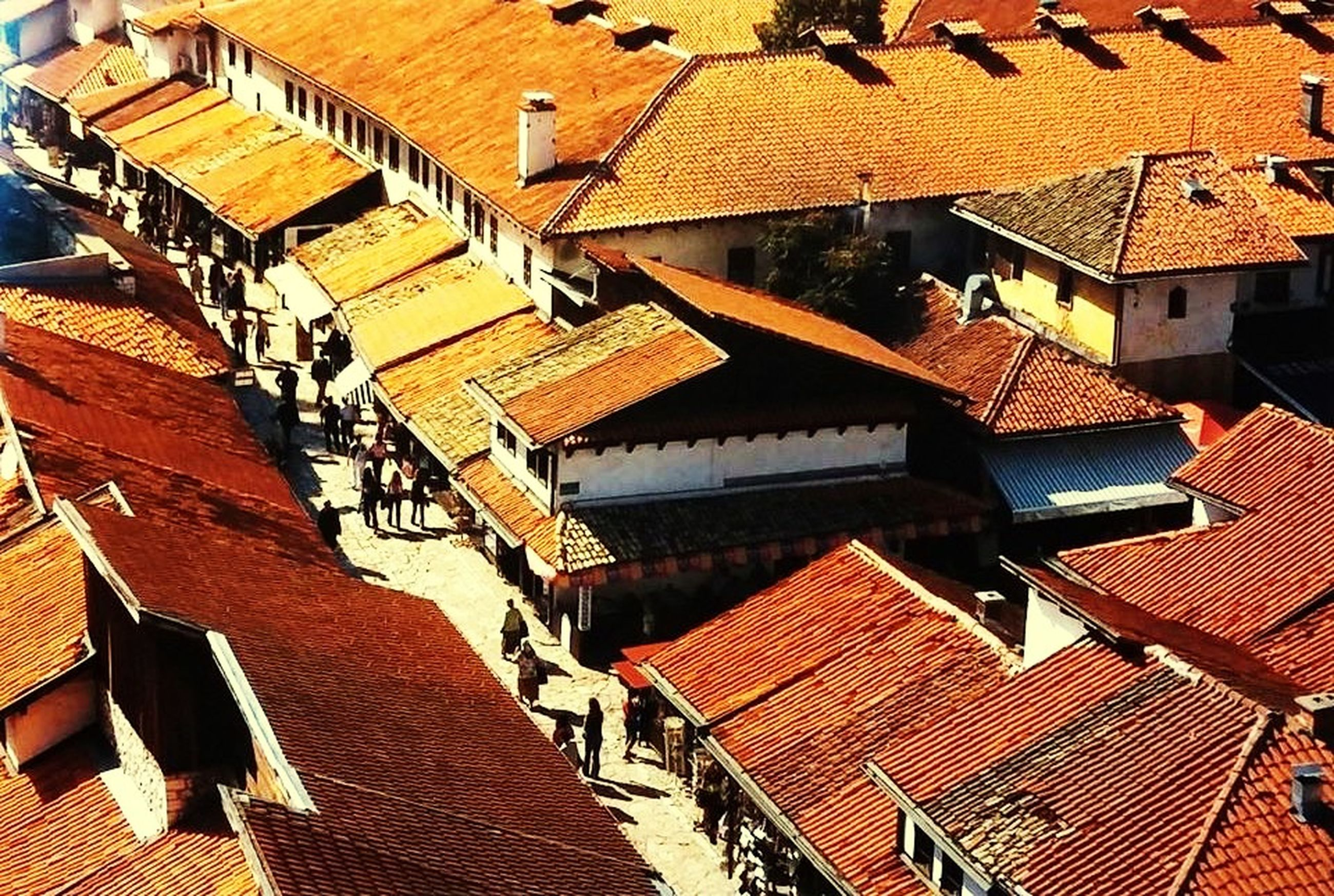roof, building exterior, built structure, architecture, roof tile, high angle view, house, residential structure, abundance, residential building, large group of objects, outdoors, sunlight, day, in a row, repetition, rooftop, no people, town, residential district