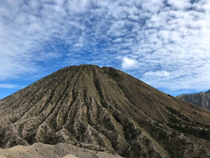 Beauty In Nature Bromo Cloud - Sky Crater Day Environment Formation Geology Idyllic Land Landscape Low Angle View Mountain Mountain Peak Nature No People Non-urban Scene Outdoors Physical Geography Scenics - Nature Sky Tranquil Scene Tranquility Volcanic Crater Volcano