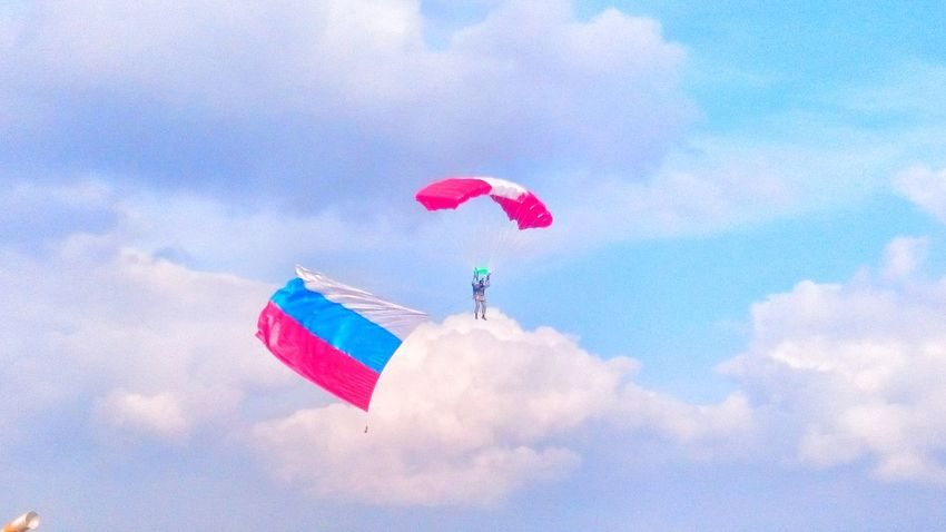 Flying Low Angle View Multi Colored Sky Mid-air Cloud Cloud - Sky Blue Adventure Day Extreme Sports Cloudy Paragliding Fun Red Vibrant Color Outdoors Colorful Skydiving Tranquility