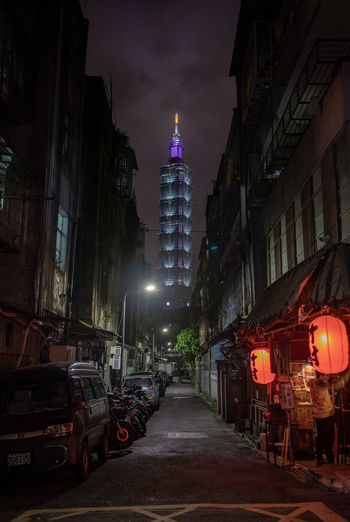 Building Exterior City Architecture Illuminated Built Structure Night Street Building Motor Vehicle Mode Of Transportation Transportation Car Residential District Land Vehicle No People Outdoors Road City Street Nature The Way Forward Office Building Exterior Skyscraper Taipei 101 Alley