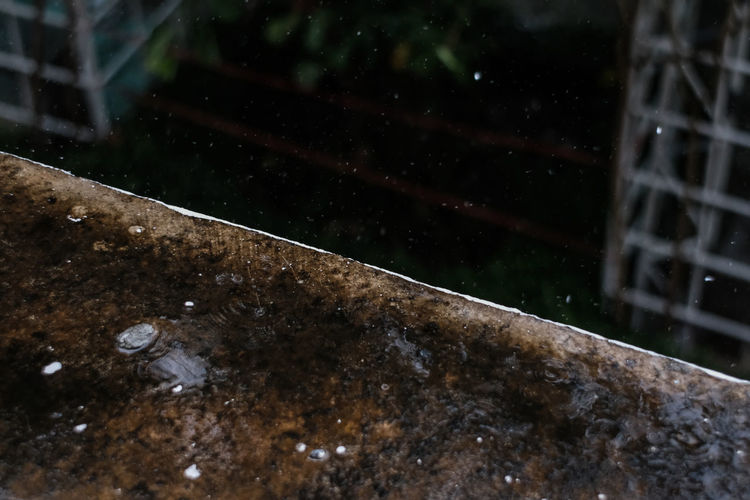 Water Wet Rain No People Nature Drop Architecture Monsoon Rainy Season Day Built Structure High Angle View Outdoors Window RainDrop Reflection Motion Purity Focus On Foreground