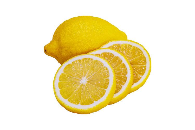 Close-up of lemon slice against white background