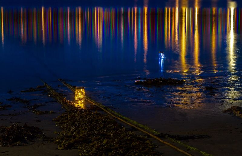 Sea Jar Lights Blue Hour Water Reflection Illuminated Sea Nature No People Tranquility Beauty In Nature Outdoors Tranquil Scene Night Beach Scenics - Nature High Angle View Transportation Land Nautical Vessel Sky Lighting Equipment HUAWEI Photo Award: After Dark