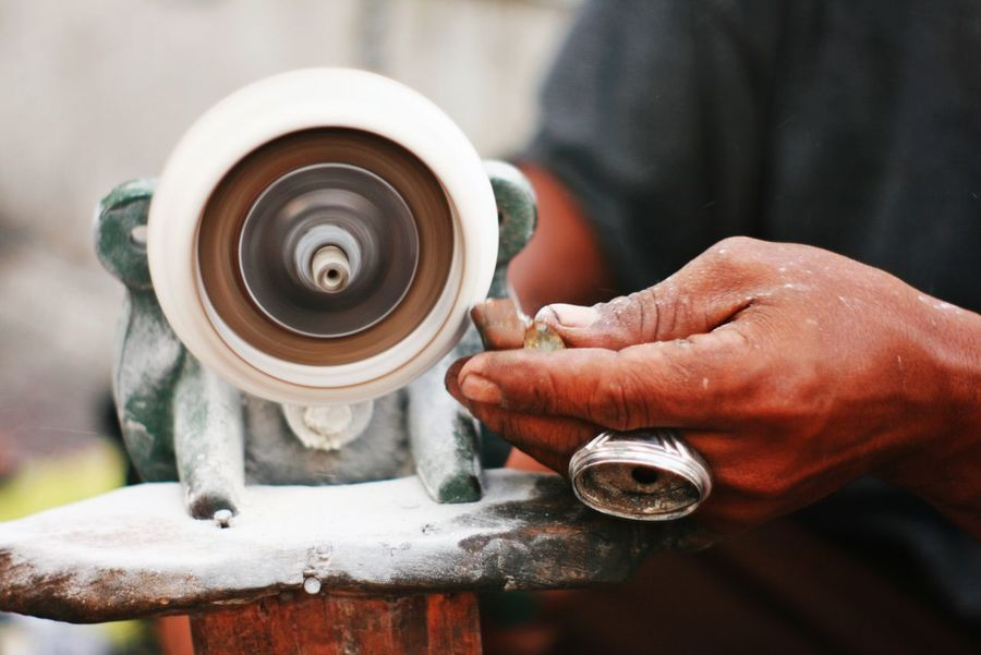 Agate craftsman in malioboro street Investing In Quality Of Life Human Hand Human Body Part Working Men Occupation One Man Only Motion Adult One Person Work Tool Workshop Day Manual Worker Metal Industry People Industry Craftman Craftman Tools Agate Agate Stone Ring