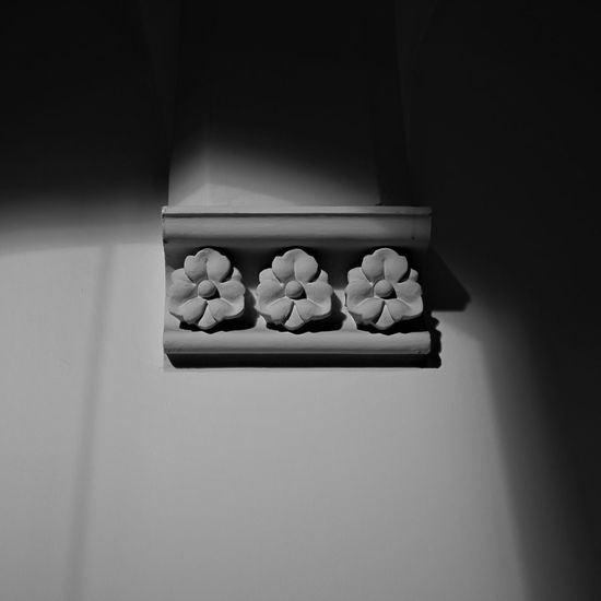 Low angle view of floral carving on wall