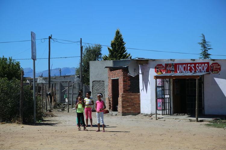 Dirt Road Friends Girls Rural Rural Scene Shop Sign South Africa