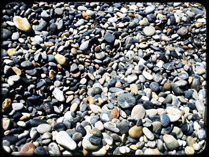 Pebble Pebble Beach Beach Stone - Object Abundance No People Beauty In Nature Outdoors Shore Full Frame Nature Large Group Of Objects Day Close-up