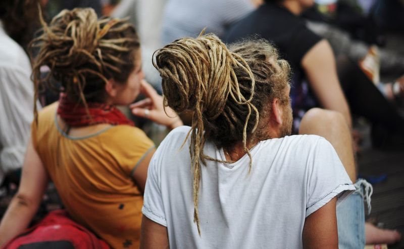 rastas 2 Berlin Casual Clothing Couple Day Enjoying Life Focus On Foreground From Behind Hair Style Hairstyle Headshot Leisure Activity Lifestyles Long Hair Same Same But Different Sitting Street Street Photography Streetphotography Unrecognizable Person
