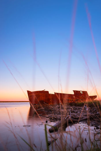 Shipwreck at the Wairau Lagoons Rust Travel Beauty In Nature Idyllic Metal Nature Nautical Vessel New Zealand No People Outdoors Scenics - Nature Sea Shipwreck Sky Sunset Tranquil Scene Tranquility Water