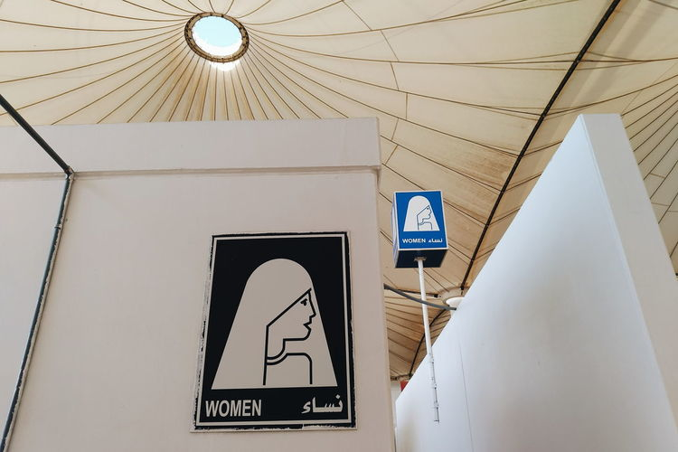 Low angle view of female sign in public restroom