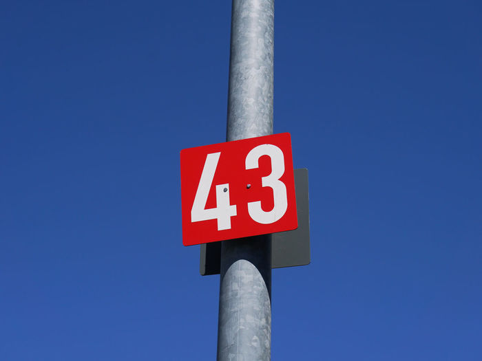 43 Blue Clear Sky Copy Space Day Low Angle View No People Number Number 43 Numbers Pole Red Sign Sky Text