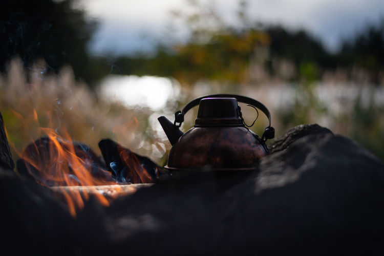 Close-up of teapot on fire
