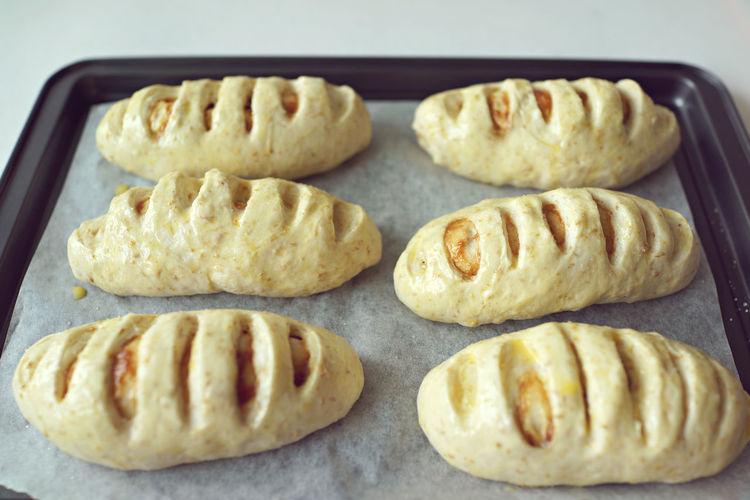 High Angle Of Raw Bun Pastries On Baking Sheet