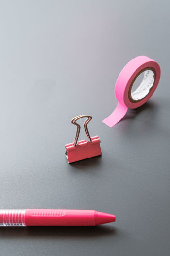 Close-up of pink equipment on table against gray background